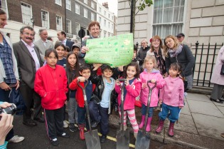 Children from International Community School's Eco-Team presented a cheque of £300 to Julian Maslinski, Chairman of Westminster Tree Trust at the New Cavendish Street Planting
