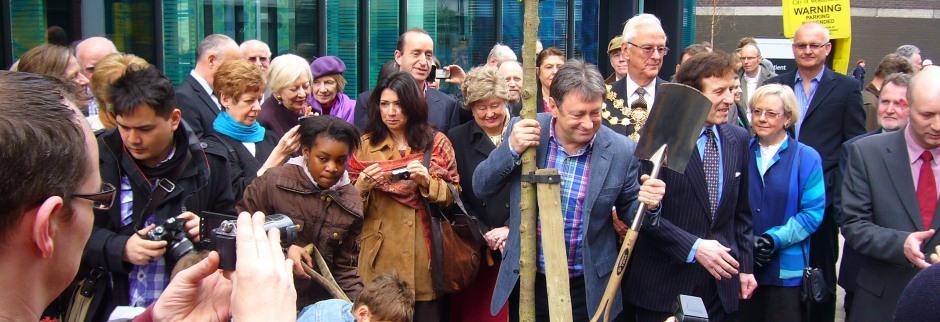 Alan plants a New Horizon Elm outside the Royal National Orthopaedic Hospital