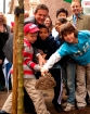 Mathew Wright assisted by school children from ICS plant trees on Hallam Street