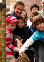 Mathew Wright and local children plant trees in Marylebone