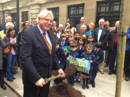 John Simpson of the BBC and St Vincent;s Green Team plant 500th tree