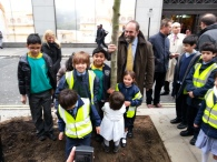 The 600th tree is packed down by David Heath MP, Minister for Environment and little helpers